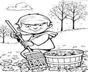 Printable boy rake pick up the leaves coloring pages